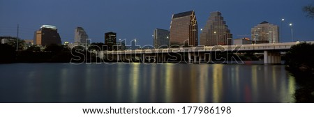 This is the State Capitol and skyline at sunset. The city is on the Colorado River. It is called the live music capitol. - stock photo