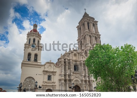 This is the very lovely Cathedral de Santiago.The front facade is very exuberant and baroque. It has beautifully carved heavy wooden doors in the front. Inside the church has a single aisle  - stock photo