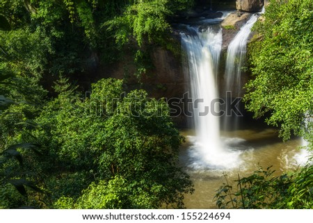 this is the waterfall in the national forest in thailand. this photo is taken on rainy season. the stream is very heavy and dangerous.