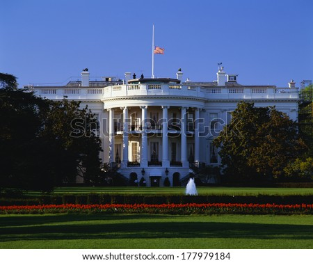 This is the White House in daylight during the summer. It is located on Pennsylvania Avenue. This is the home of the President of the United States.