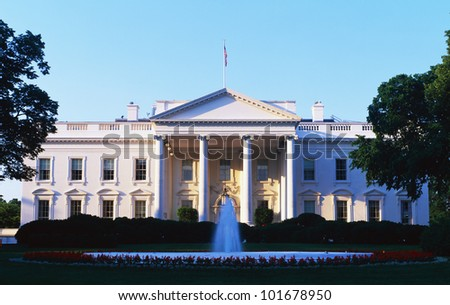 This is the White House in daylight. We see the fountain running in front.