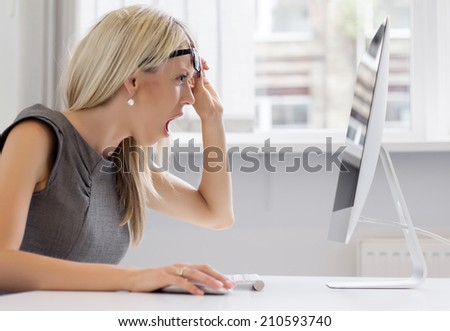 This is too much! Young woman can't handle that workload anymore. - stock photo