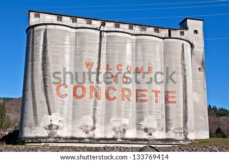 This large concrete silo is the official town welcome sign of Concrete, Washington.  A rural community in the foothills of Western Washington. - stock photo