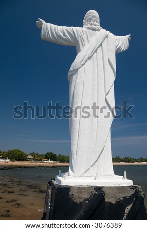 This large statue of Jesus lies 300 feet from the shore north of El Salvador's only tourist resort. - stock photo