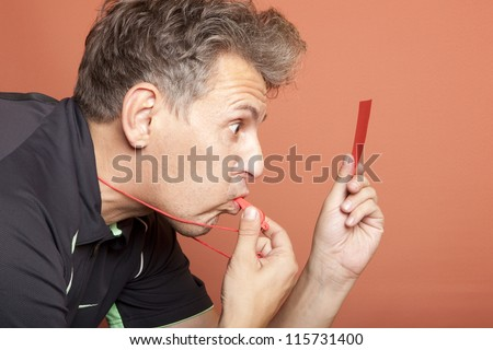 This male referee has gone mad - stock photo