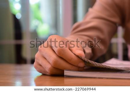 this man reading interest page magazine - stock photo