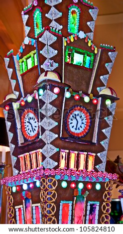 This massive candy gingerbread house is a large, intricate tower with candy windows, doors and much more set in a vertical format.  Great holiday image.