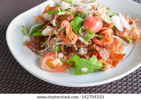 This menu is sliced sheets of dried and crispy pork mixed with spicy salad.