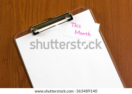 This Month; White Blank Documents with Small Message Card.