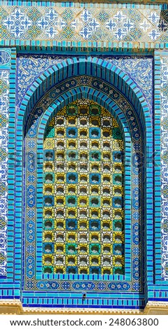 This mosaic window is one of many colorful windows in the Dome of the Rock - stock photo