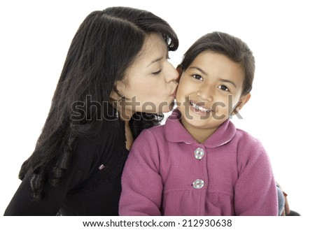 This mother give a kiss to her little daughter they love each other. - stock photo