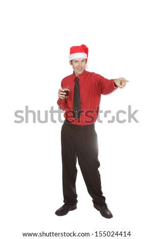 This office worker points at someone across the room while holding his glass at the holiday party. - stock photo