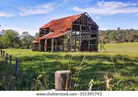 This old ramshackle rustic glory a once grand two storey barn with corrugated roof and timber trusses now just a skeleton of what it formerly was,