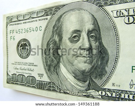 This photo illustration of Ben Franklin with a black eye on a one hundred dollar bill might illustrate a tough economy, inflation, unemployment or economic recession,or budget cuts etc. - stock photo