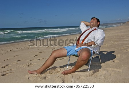 This photo shows a business men (Ricardo), relaxing and catching sun on the beach