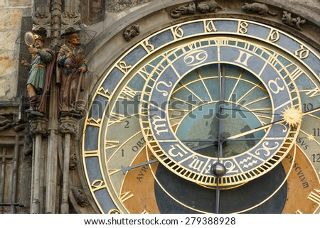 This photo shows a closeup of Prague old tower clock. There are various details like figurines, numbers, symbols and others.  - stock photo
