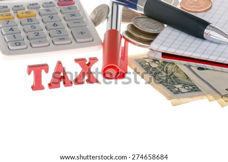 This photo shows a closeup of tax sign, calculator, marker, banknotes, coins and paper on white background. - stock photo