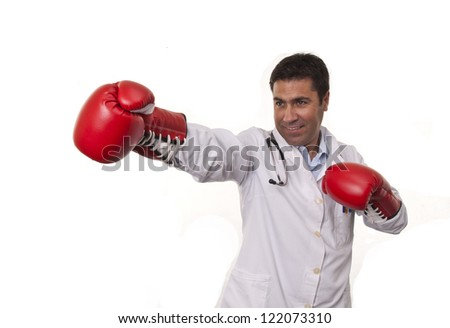 This photo shows a doctor wearing boxing gloves on a  attacking position,  isolated on white background.