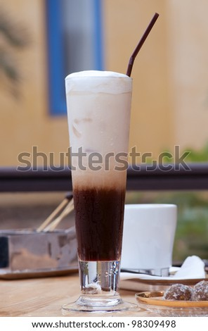 this picture is a glass of ice coffee - stock photo