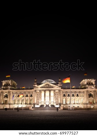 This picture shows the front of the Reichstag-Building in Berlin at night - stock photo