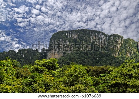 This prehistoric limestone range rings Kuala Lumpur city. - stock photo