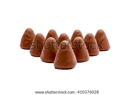 This pyramid shape of an cuberdons is a very tasty candy from Ghent in chocolate - stock photo