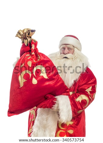This Santa Claus congratulates on a white background with a bag of gifts - stock photo