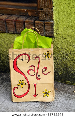 This sign tells customers walking by that there are bargains to be had. - stock photo