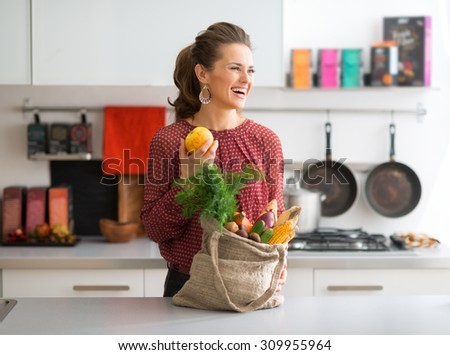 This sweet and crisp apple is just for me and impossible to resist. In the bag, the bounty of the autumn, with a variety of fresh fall vegetables. - stock photo