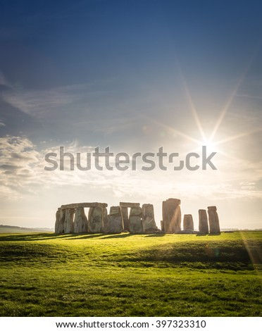 This vertical image of Stonehenge provides a crowd-free view of the grassy fields and sunny blue sky. - stock photo
