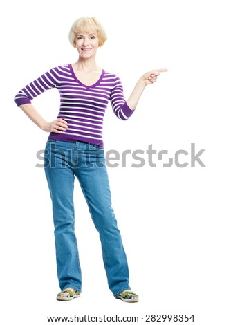 This way. Advertising your product. Full length portrait of happy elderly woman pointing copy space and smiling while standing isolated on white - stock photo
