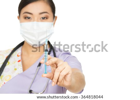 This will hurt a bit. Studio portrait of a female doctor holding out a syringe isolated on white copyspace on the side - stock photo