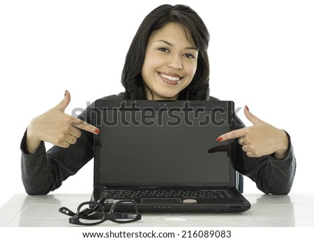 This young lady is sitting with her computer and she is pointing something