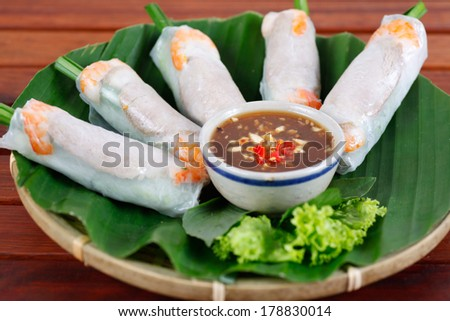 THIT LUOC CUON BANH TRANG - Wrapped rolls ( with boiled pork, shrimp, garlic chives) served with soy sauce, typical appetizer Vietnamese food. - stock photo