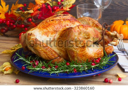 Thnaksgiving dish - turkey with pumpkins and fall leaves - stock photo