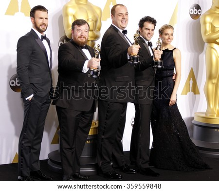 Thomas Curley, Ben Wilkins, Craig Mann, Chris Evans and Sienna Miller at the 87th Annual Academy Awards - Press Room held at the Loews Hollywood Hotel in Los Angeles, USA on February 22, 2015. - stock photo