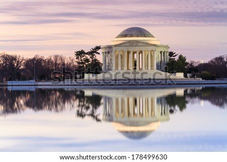 Thomas Jefferson Memorial in Washington, DC at sunrise reflecting in the Tidal Basin. - stock photo