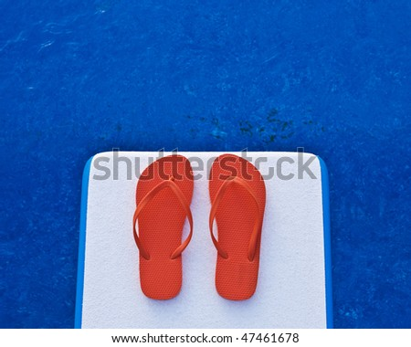 Thongs on a diving board - stock photo