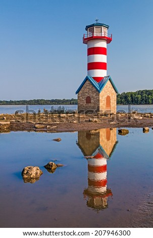 Though not a functional aid to navigation, the Grafton, Illinois Lighthouse stands to commemorate the Great Flood of 1993 which nearly washed away the small Mississippi River town. - stock photo