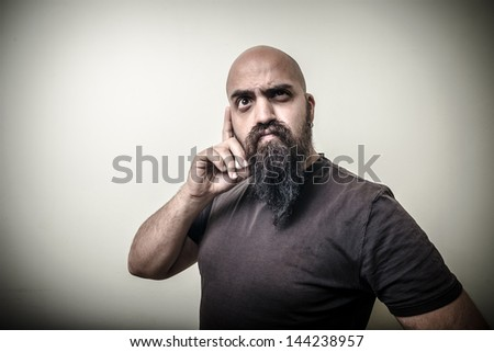 thoughtful bearded man isolated on gray background