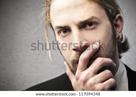 Thoughtful blonde businessman