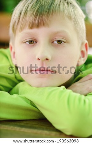 thoughtful boy looking at the camera - stock photo