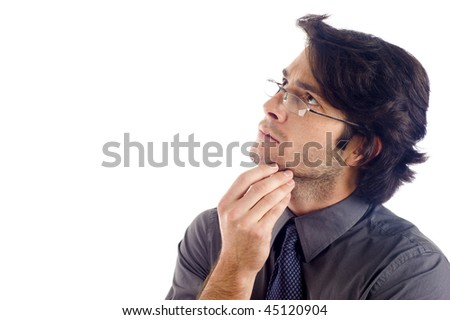 Thoughtful business man looking up at copyspace isolated over white background