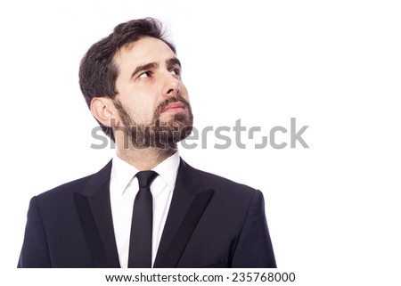 Thoughtful business man looking up, isolated on white background - stock photo