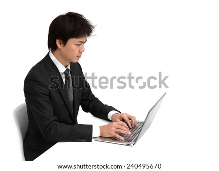 Thoughtful business man working a laptop - isolated over a white background