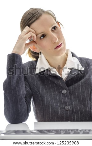 Thoughtful business woman dreaming about something at her office desk. - stock photo