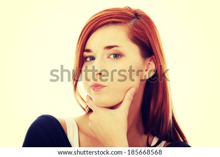 Thoughtful business woman, isolated over a white background  - stock photo