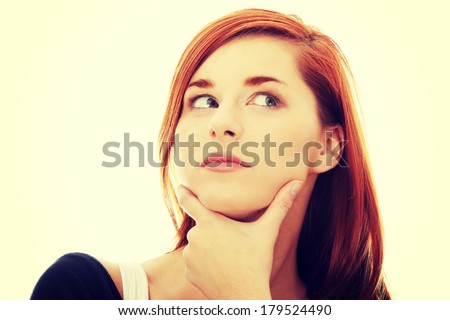 Thoughtful business woman looking right - stock photo