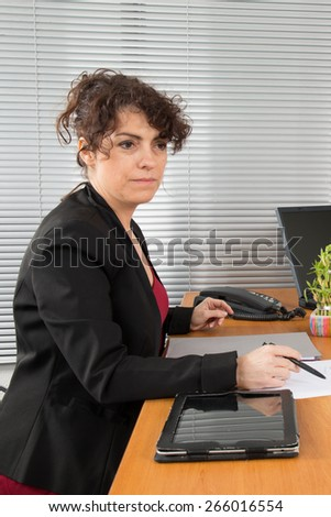 Thoughtful business woman thinking