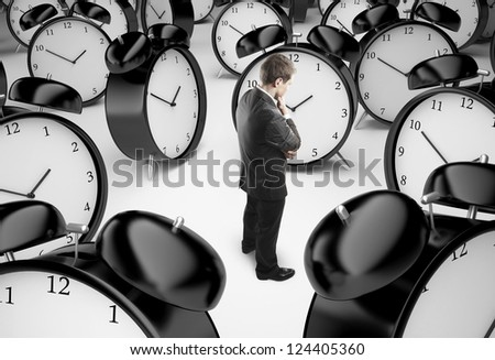 thoughtful businessman and alarm clocks - stock photo